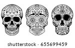set of hand drawn sugar skulls... | Shutterstock .eps vector #655699459