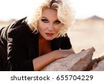 sexy woman with blond curly... | Shutterstock . vector #655704229
