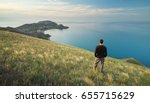 man on the edge. cliff of... | Shutterstock . vector #655715629