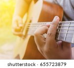 man hands playing acoustic... | Shutterstock . vector #655723879
