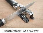 knife sharpener and knife on a...   Shutterstock . vector #655769599