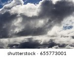 Small photo of Picturesque middle level altocumus and altostratus with low cumulo nimbus cloud formations on a sunny afternoon in mid winter are contrasted against the blue Australian sky.
