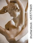 Small photo of love and psyche marble statue