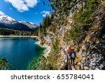 hike road along braies lake ... | Shutterstock . vector #655784041