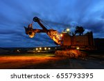 silhouette of drag line working ... | Shutterstock . vector #655793395