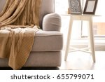 cozy grey couch with plaid in... | Shutterstock . vector #655799071