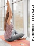 young woman practicing yoga and ... | Shutterstock . vector #655831525