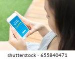 Small photo of Customer review rating business concept, Woman hand using mobile phone