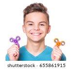 young teen boy holding popular... | Shutterstock . vector #655861915