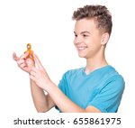 young teen boy holding popular...   Shutterstock . vector #655861975