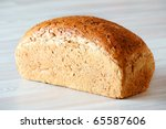 Loaf of bread on kitchen table - stock photo