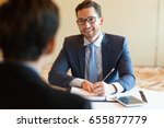 smiling manager interviewing... | Shutterstock . vector #655877779