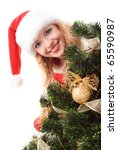 cheerful santa girl face and New-year's tree. Copy text. Christmas greetings card - stock photo