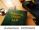 personal injury law book on a... | Shutterstock . vector #655934644