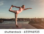 sporty girl is doing yoga on a... | Shutterstock . vector #655946935