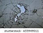 window pane smashed | Shutterstock . vector #655949011