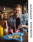portrait of man having burger... | Shutterstock . vector #655955194
