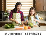 happy mother and daughter... | Shutterstock . vector #655956361