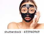woman in cosmetic mask on... | Shutterstock . vector #655960969
