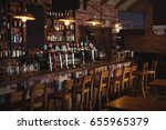 empty chairs arranged in pub | Shutterstock . vector #655965379
