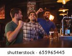 group of male friends watching... | Shutterstock . vector #655965445