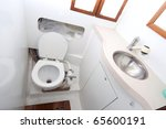 Latrine and shower on sailing boat with toilet paper - stock photo