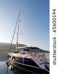 Sailing boat in turkish marine at sunrise - stock photo