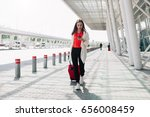 woman with red suitcase walks... | Shutterstock . vector #656008459