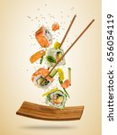 flying sushi pieces served on... | Shutterstock . vector #656054119