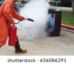 fire fighter spray co2 to fire. | Shutterstock . vector #656086291