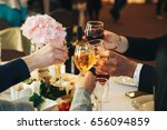 clinking glasses with alcohol... | Shutterstock . vector #656094859