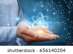 atom molecule in female hands...