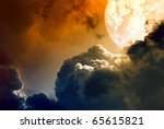 Abstract glowing planet above dark clouds - stock photo