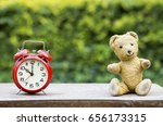 alarm clock and toy bear  ... | Shutterstock . vector #656173315