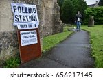 Small photo of Bradford on Avon, UK - June 8, 2017: A voter leaves a polling station at a village church. Polling stations have opened across the nation as voters decide UK's government in a general election.