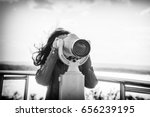 Young Woman Looking In Spyglass
