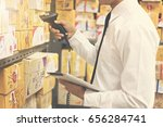 worker checking and scanning... | Shutterstock . vector #656284741