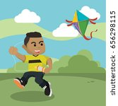 african boy playing kite in park | Shutterstock .eps vector #656298115