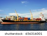 Small photo of Labuan,Malaysia-May 26,2017:Container ship with full of cargo docked in port of Labuan,Malaysia.The abolishment of cabotage policy is set to benefit this duty-free-island economically.
