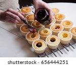 Baking Cupcakes. Filling Jam B...