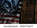 usa flag on a wood surface | Shutterstock . vector #656472637