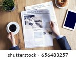 reading newspaper on desk | Shutterstock . vector #656483257