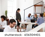 woman talking with colleagues... | Shutterstock . vector #656504401