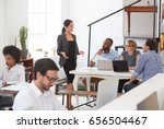 woman talking to colleagues at... | Shutterstock . vector #656504467