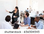 woman presenting a meeting at a ... | Shutterstock . vector #656504545
