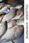 Small photo of Tilapia fresh fish sale at market.Cichlidae,Oreochromis niloticus,freshwater fish