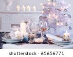 Place setting for Christmas in white with white Christmas tree - stock photo