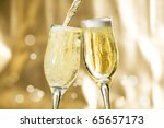 Pair of champagne flutes making a toast. - stock photo