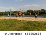 men playing beach volleyball.... | Shutterstock . vector #656603695