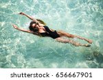 woman diving in the clear water ... | Shutterstock . vector #656667901
